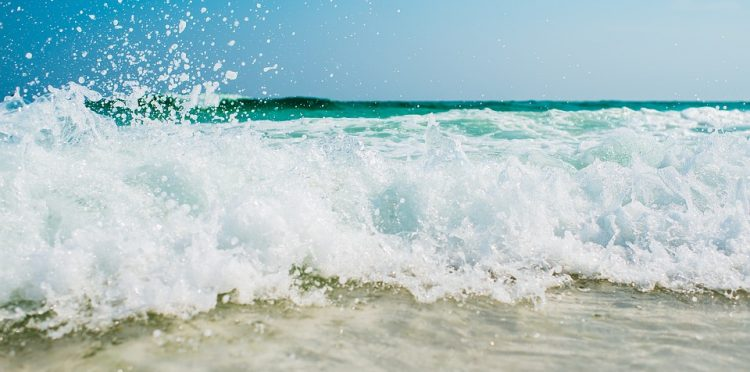 A Picture of Waves At The Beach By A Hotel